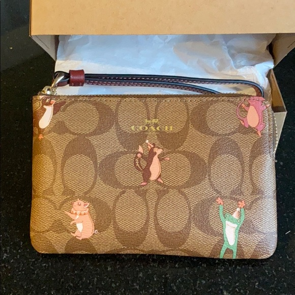 New with tag coach party animal wristlet